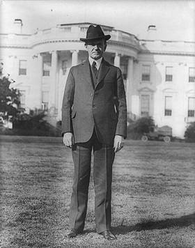 Calvin Coolidge in front of the White House